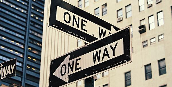 One ways signs pointing in different directions