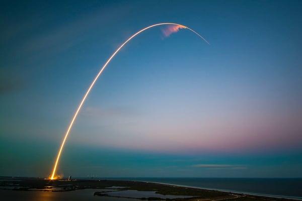 Rocket launching at sunrise