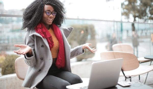 Woman hosting webinar with laptop outside